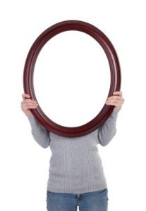 Woman Holding Blank Mirror